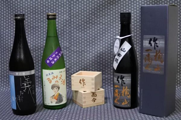 三重で仕入れた日本酒と升の画像